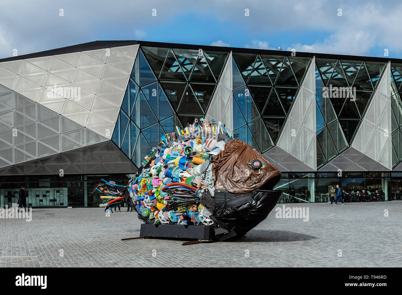 HELSINGOR DENMARK; MARCH 24, 2019: The modern architecture of the Cultural Centre, and a statue of a fish made of plastic rubbish. - Stock Image