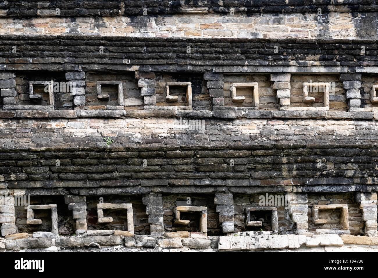 Details of decorated stone niches on Building C at the pre-Columbian archeological complex of El Tajin in Tajin, Veracruz, Mexico. El Tajín flourished from 600 to 1200 CE and during this time numerous temples, palaces, ballcourts, and pyramids were built by the Totonac people and is one of the largest and most important cities of the Classic era of Mesoamerica. - Stock Image