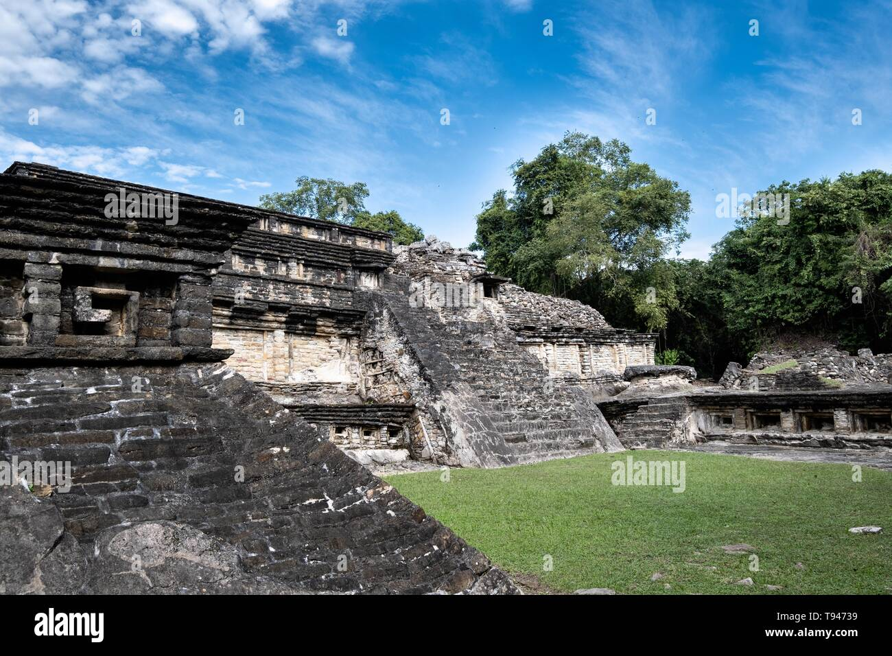 Mesoamerica residents called the Tajin Chico at the pre-Columbian archeological complex of El Tajin in Tajin, Veracruz, Mexico. El Tajín flourished from 600 to 1200 CE and during this time numerous temples, palaces, ballcourts, and pyramids were built by the Totonac people and is one of the largest and most important cities of the Classic era of Mesoamerica. - Stock Image