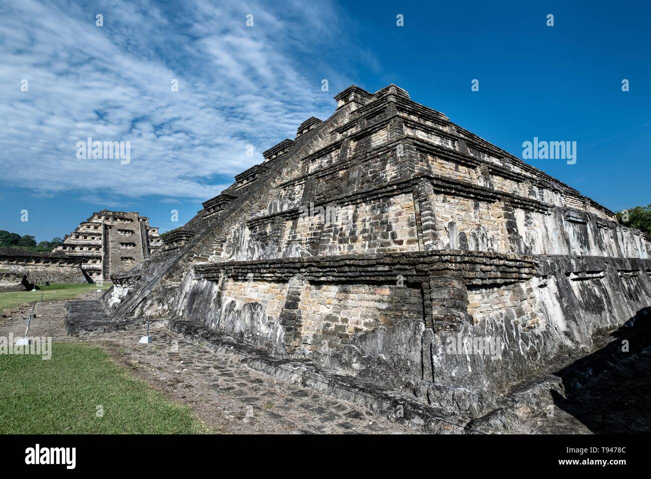 Mesoamerica Blue Temple Pyramid, right, and the Pyramid of the Niches, left, at the pre-Columbian archeological complex of El Tajin in Tajin, Veracruz, Mexico. El Tajín flourished from 600 to 1200 CE and during this time numerous temples, palaces, ballcourts, and pyramids were built by the Totonac people and is one of the largest and most important cities of the Classic era of Mesoamerica. - Stock Image