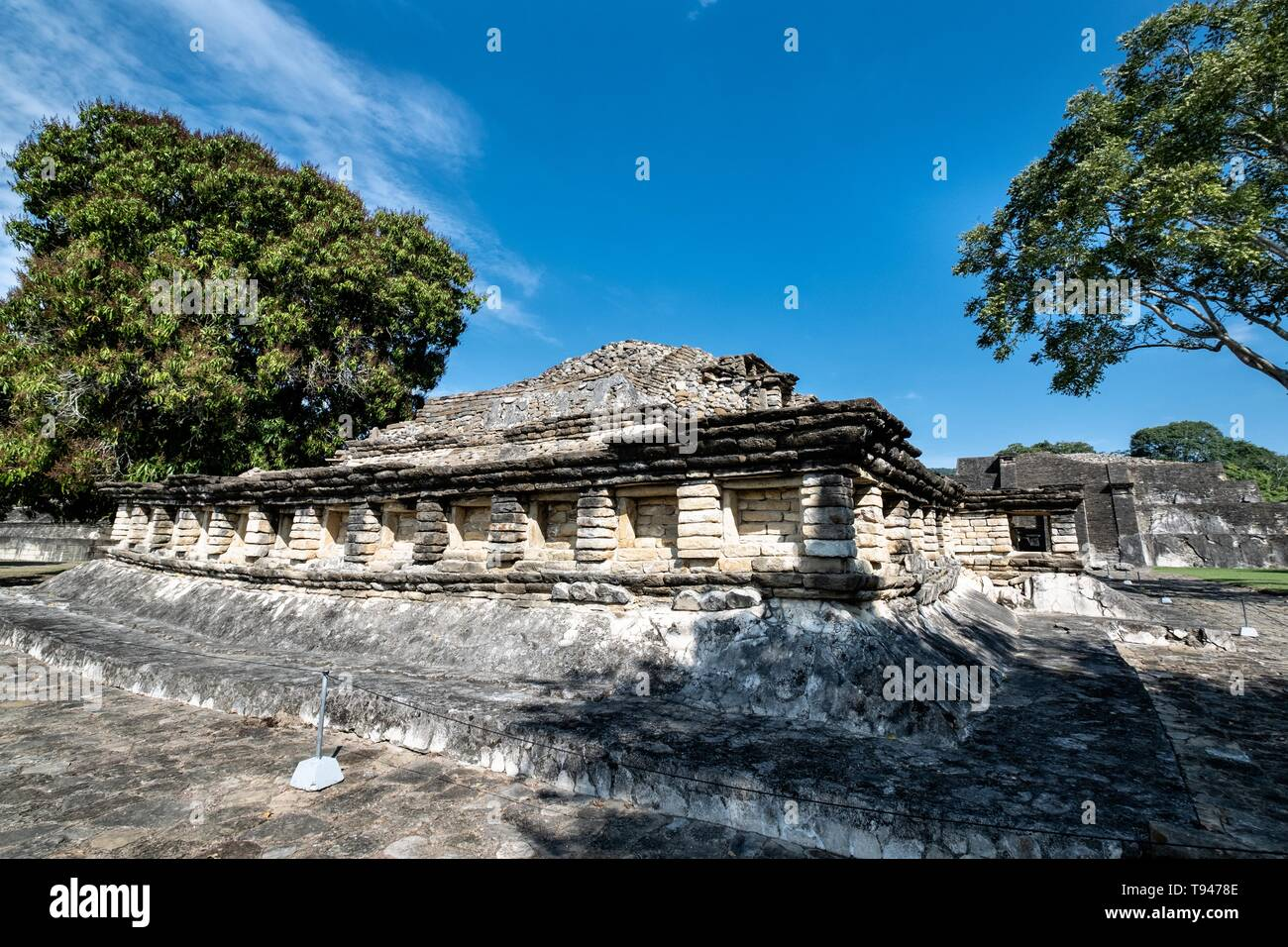 Mesoamerica residents called Tajin Chico at the pre-Columbian archeological site of El Tajin in Tajin, Veracruz, Mexico. El Tajín flourished from 600 to 1200 CE and during this time numerous temples, palaces, ballcourts, and pyramids were built by the Totonac people and is one of the largest and most important cities of the Classic era of Mesoamerica. - Stock Image
