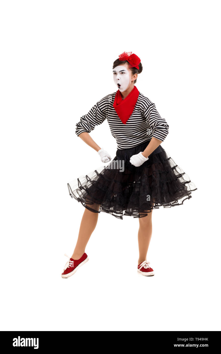 Full length portrait of angry mime woman artist looking at camera isolated on white background - Stock Image