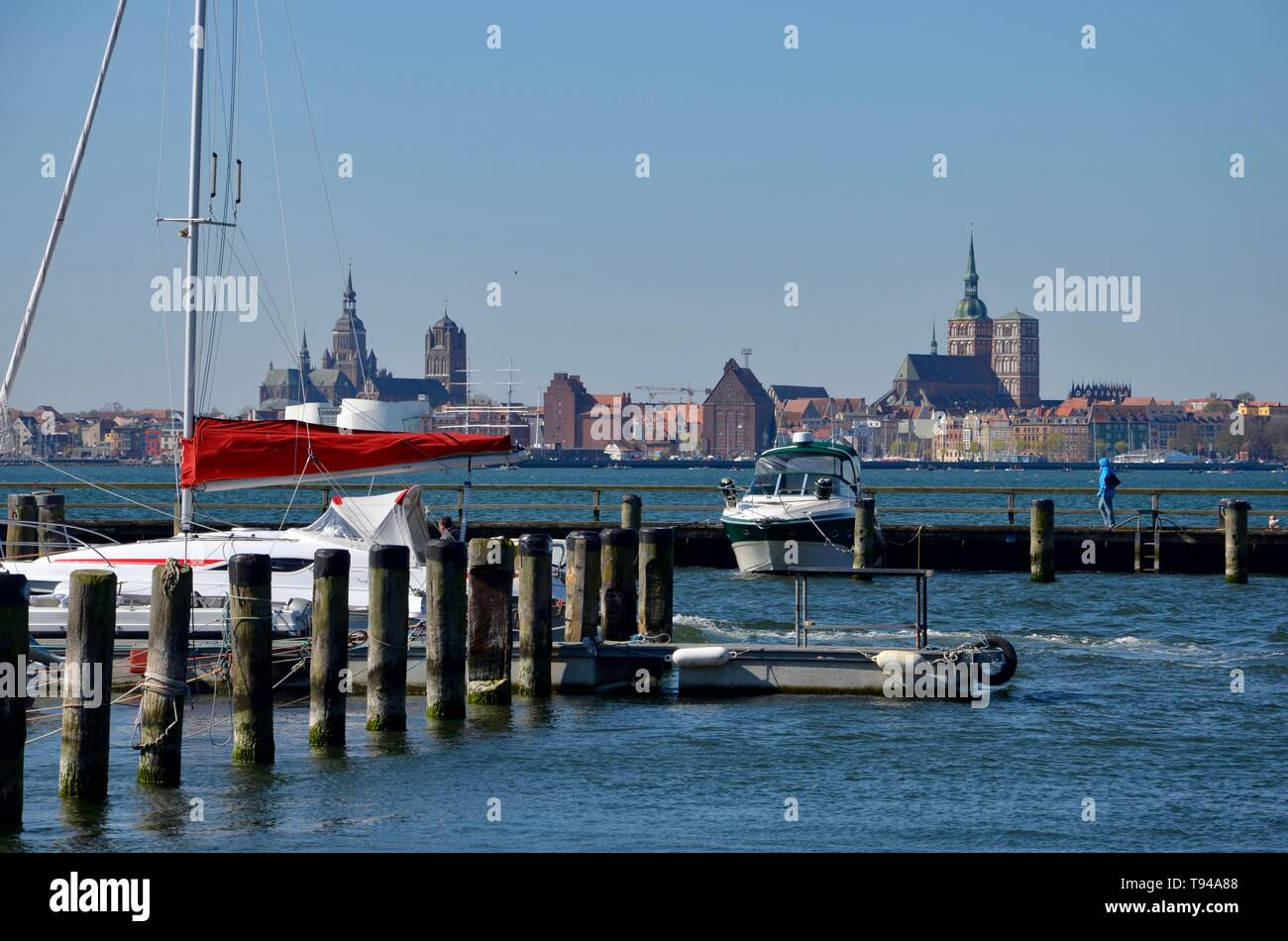 Island Ruegen in Germany, Mecklenburg West Pomerania, Baltic sea, harbor of the spa town Altefaehr,view to the skyline of the hanseatic city Stralsund - Stock Image