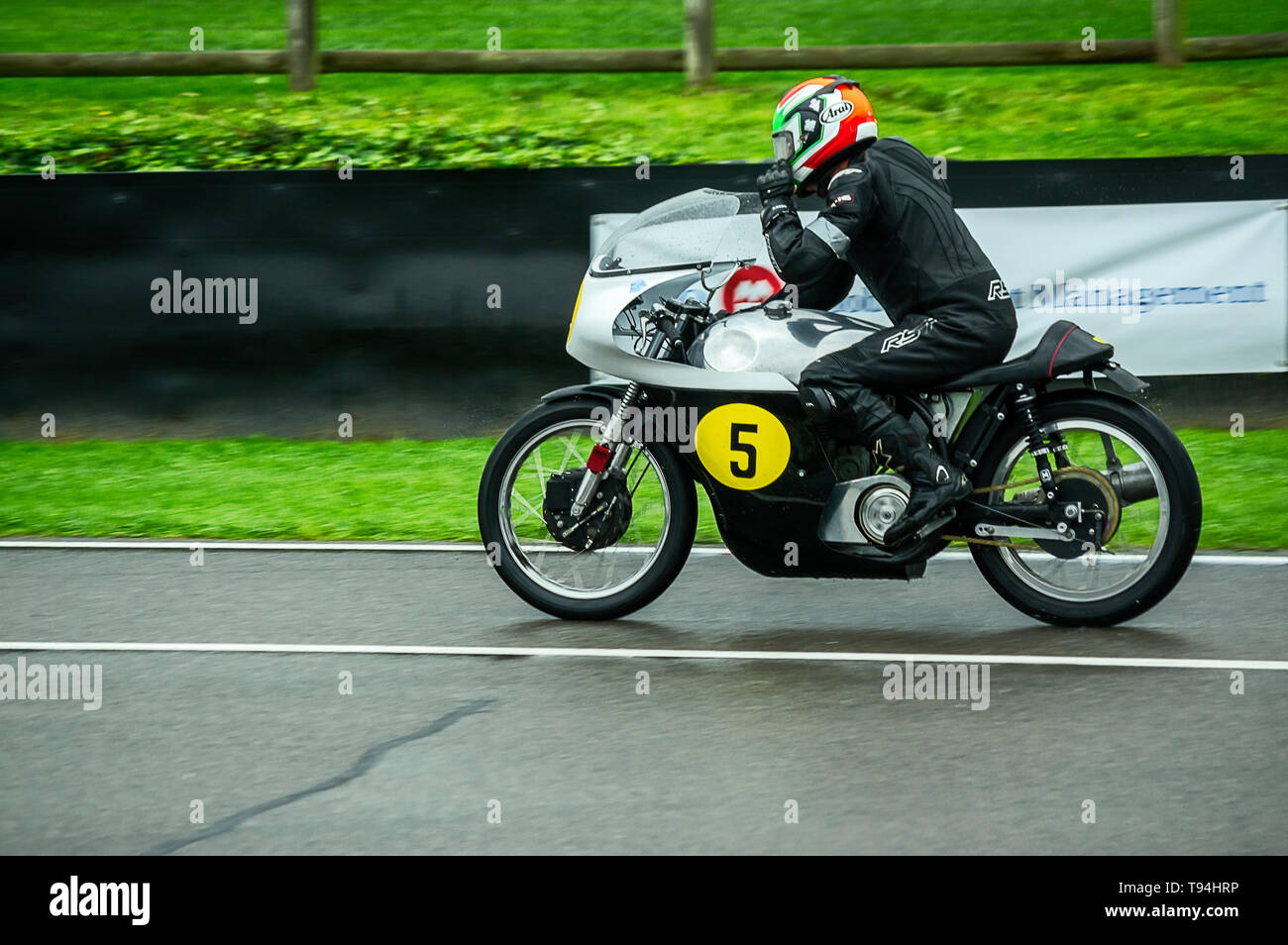 A classic motorbike on the track at Goodwood Revival 2017 Stock Photo