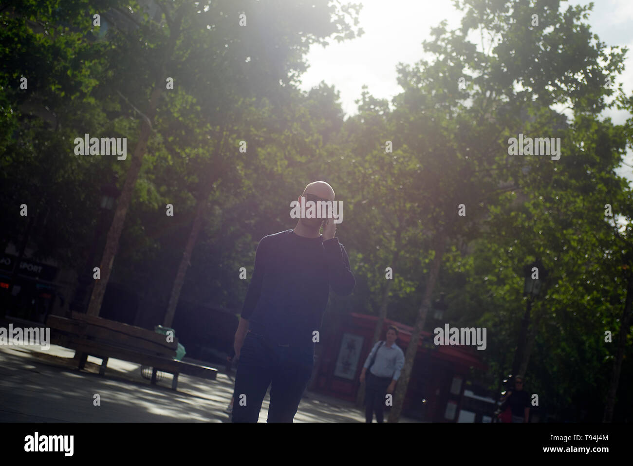 A local business man strolling and walking in the city centre of Paris exploring the city and its sights - Stock Image