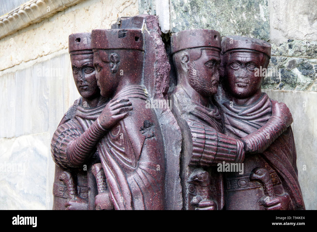 The red porphyry sculptured figures of the Tetrarchy, the four joint rulers of the Roman empire, looted from Constantinople in 1204 and now in Venice. - Stock Image
