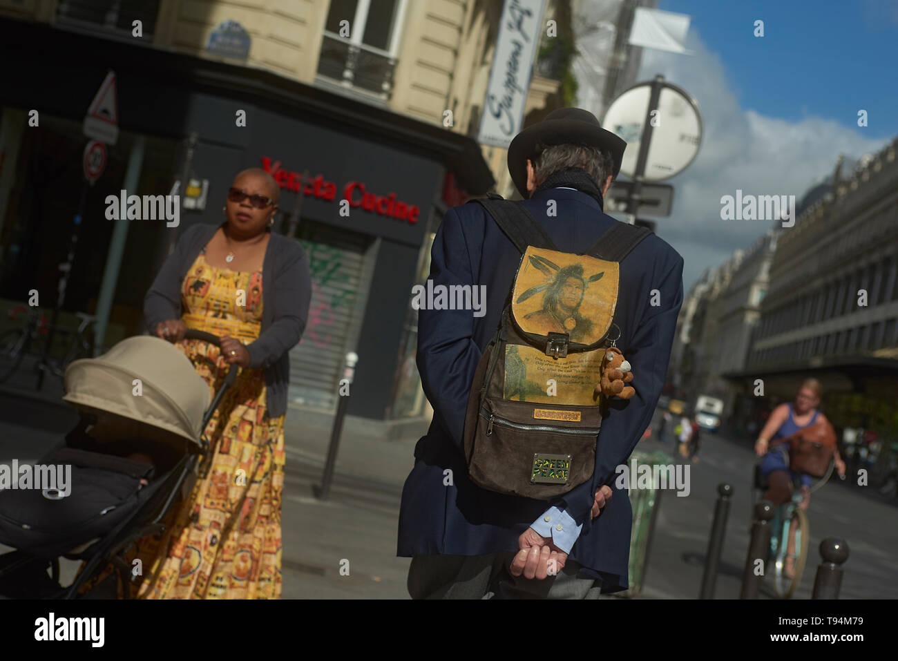 A man strolling and walking in the city centre of Paris exploring the city and its sights Stock Photo