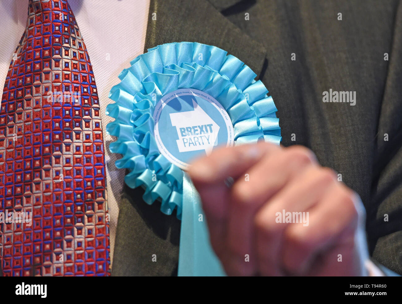 A rosette on the jacket of Brexit Party leader Nigel Farage at Sugar Hut in Brentwood, Essex, while on the European Election campaign trail. Stock Photo