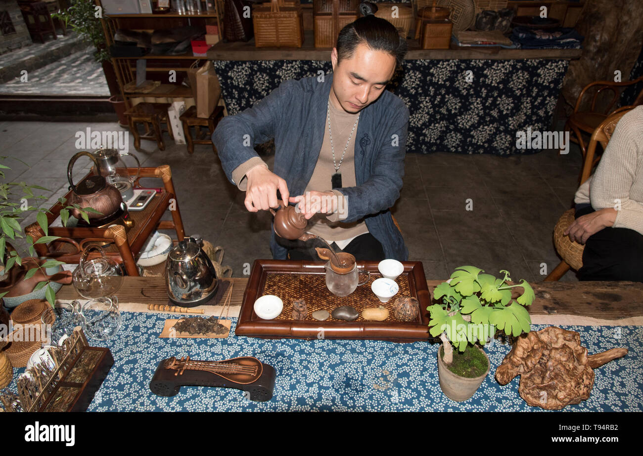Chinese Tea Ceremony. Male server prepares the traditional tea. photographed in Chengdu, Sichuan, China - Stock Image