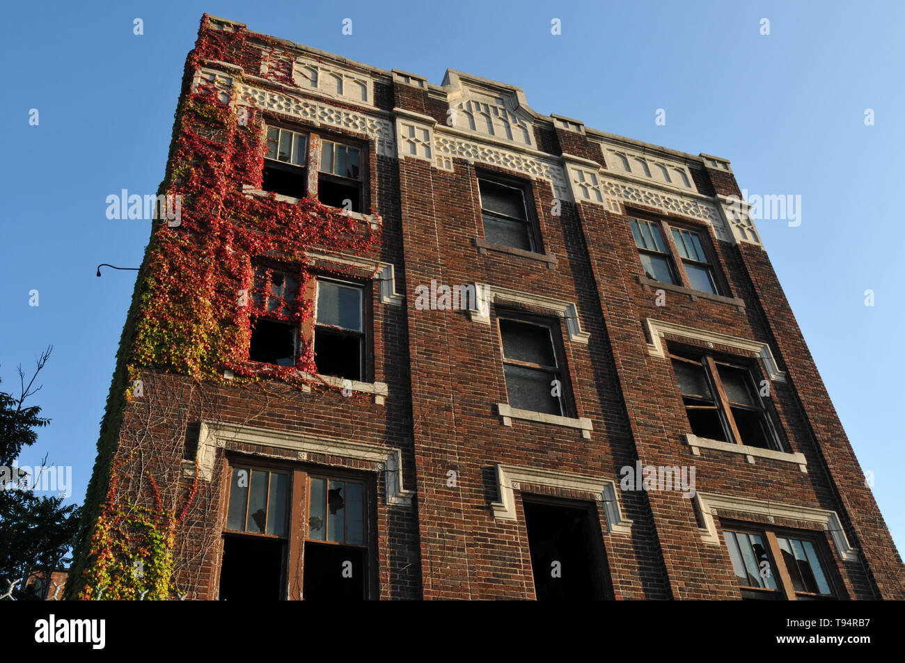 An abandoned, vacant apartment building, with many of its windows broken, is pictured in Detroit, Michigan. - Stock Image