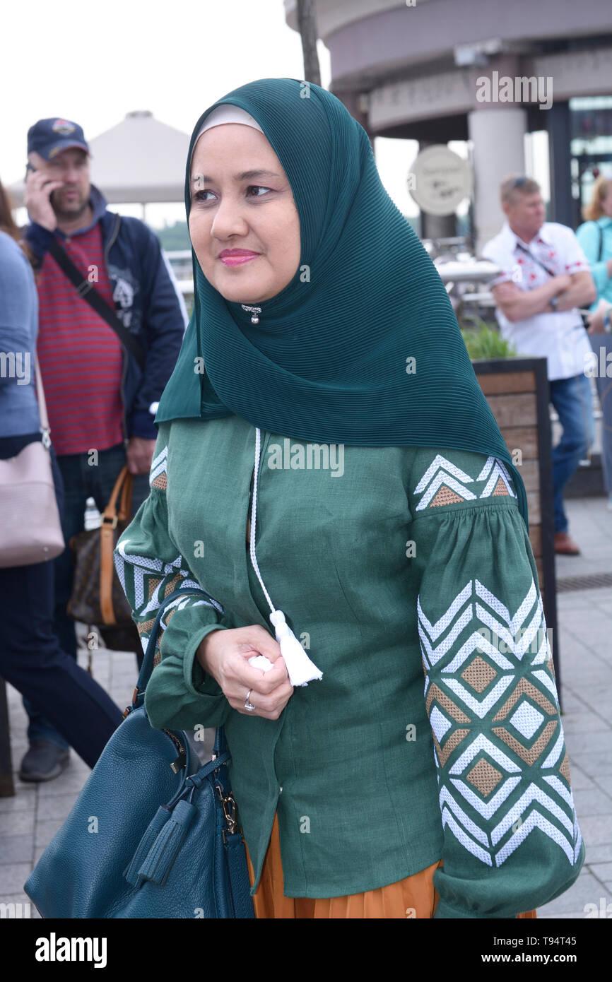 Muslim woman in hijab wearing Ukrainian embroidered  shirt. Celebration of Embroidered shirt Day. May 16, 2019. Kiev, Ukraine Stock Photo