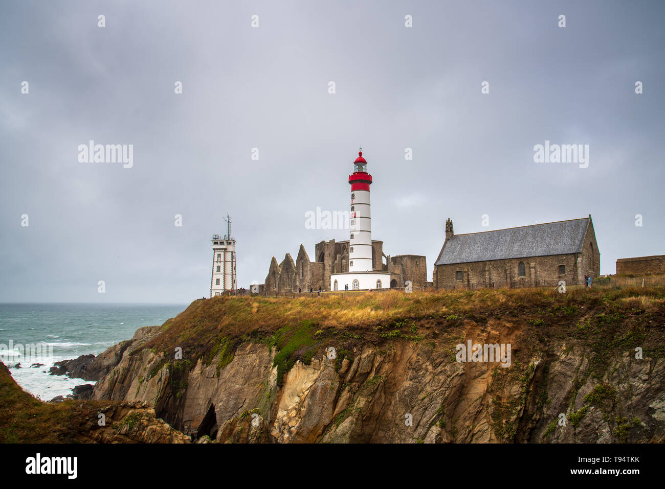 Plougonvelin, France - July 29, 2018: Pointe Saint Mathieu Lighthouse in Brittany, France. A cloudy day Stock Photo