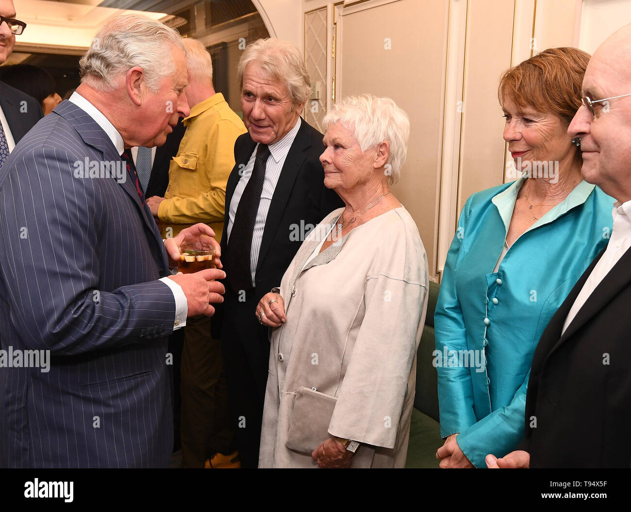 The Prince of Wales talks with Dame Judi Dench and her partner David Mills, watched by Celia Imrie at the annual Fortnum & Mason Food and Drink Awards at Fortnum & Mason, central London. - Stock Image