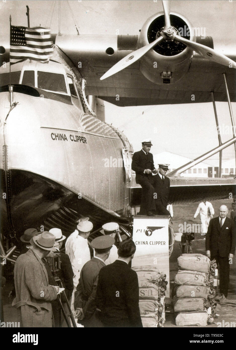 China Clipper (NC14716) was the first of three Martin M-130 four-engine flying boats built for Pan American Airways and was used to inaugurate the first commercial transpacific airmail service from San Francisco to Manila in November 1935. Built at a cost of $417,000 by the Glenn L. Martin Company in Baltimore, Maryland, it was delivered to Pan Am on October 9, 1935. It was one of the largest airplanes of its time. On November 29, the airplane reached its destination, Manila, after traveling via Honolulu, Midway Island, Wake Island, and Guam, and delivered over 110,000 pieces of mail. During W - Stock Image