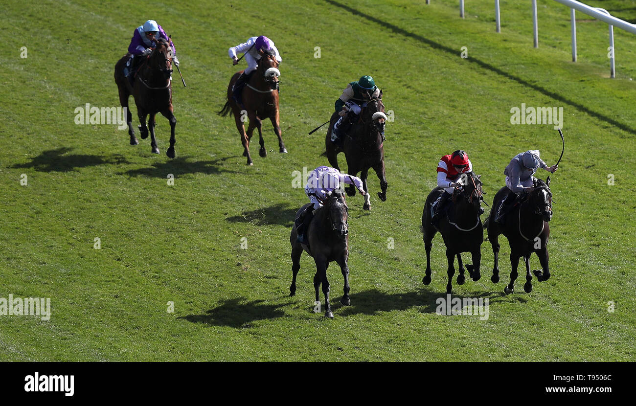 Garrus ridden by Ryan Moore (front left) wins The British Stallion Studs EBF Westow Stakes during day two of the Dante Festival at York Racecourse. - Stock Image