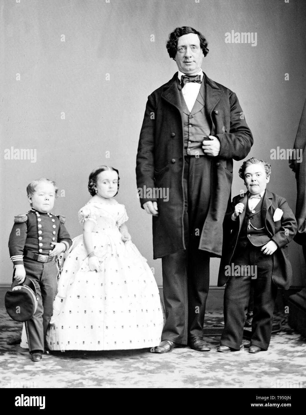 Entitled: 'Gen. Tom Thumb, Miss Lavinia Warren, The Giant.' Charles Sherwood Stratton (January 4, 1838 - July 15, 1883), 'General Tom Thumb', was an American dwarf performer. P.T. Barnum, a distant relative (half fifth cousin, twice removed), heard about Stratton and after contacting his parents, taught the boy how to sing, dance, mime, and impersonate famous people. Barnum took young Stratton on a tour of Europe, making him an international celebrity. His marriage with a little person, Lavinia Warren, became front-page news. The wedding took place at Grace Episcopal Church and the wedding rec - Stock Image