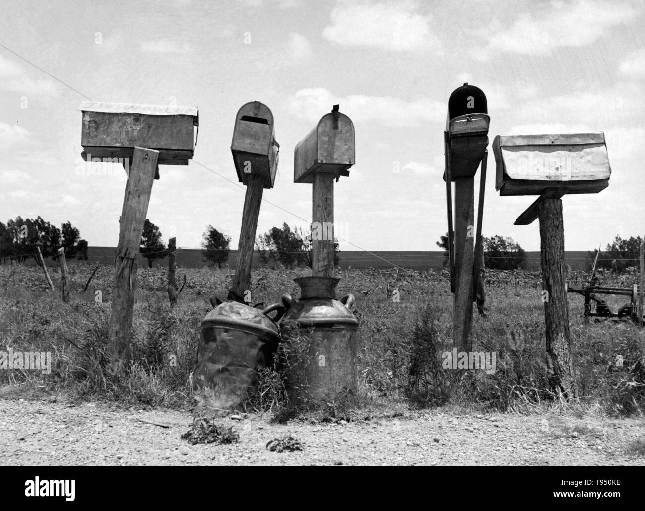 Entitled: 'Mail boxes in Bell County, Texas. Three of these mail boxes are not in use. The tenant farmers have been replaced by tractor farming.' Before the introduction of rural free delivery (RFD) by the Post Office in 1896, many rural residents had no access to the mail unless they collected it at a post office located many miles from their homes or hired a private express company to deliver it. - Stock Image