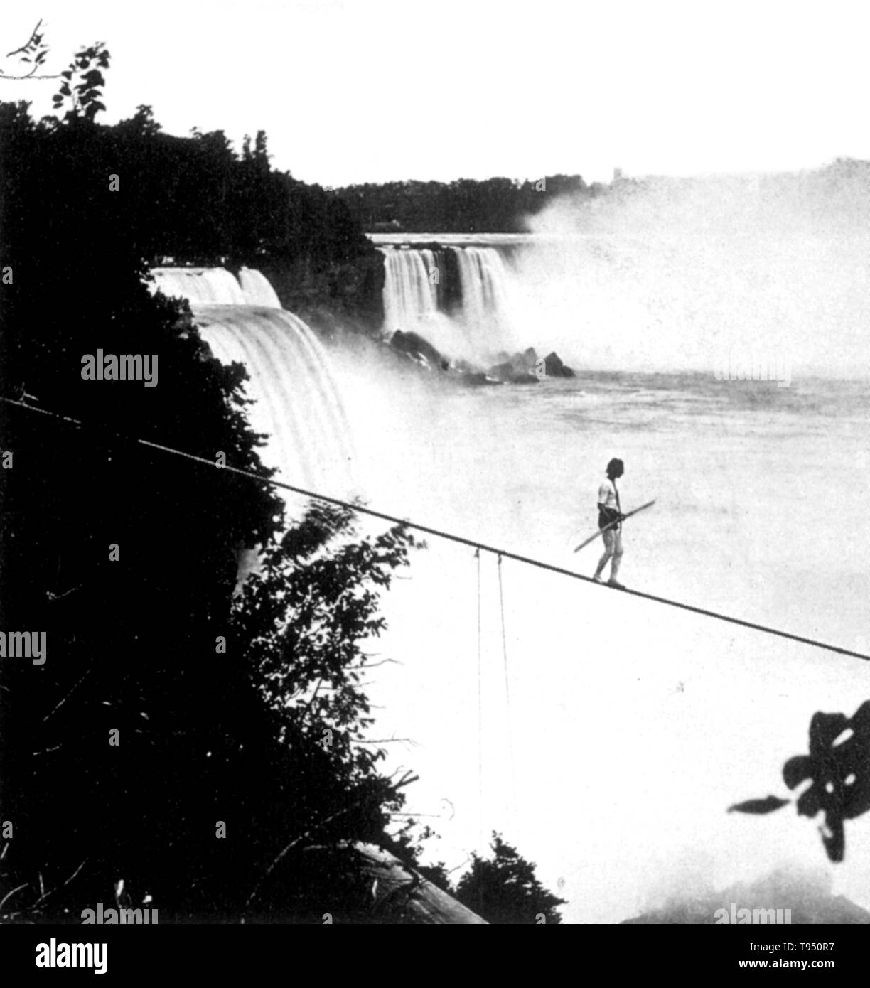 Henry Bellini (1841 - 1888) was an English tightrope walker. In 1873, at the age of 32, he went to Niagara Falls. On August 25th 1873, he made his first tight rope walk across the Niagara River using a 1,500 foot long - 2.5 inch diameter rope weighing 2,500 pounds. He combined a tight rope walk with a leap into the churning river below. He tried crossing using a 48 pound - 22 foot long balance pole. Following his leap into the water, Bellini was picked up by an awaiting boat. He made three such leaps during 1873. In the winter of 1886, he jumped from the Upper Suspension Bridge. He was hauled  - Stock Image