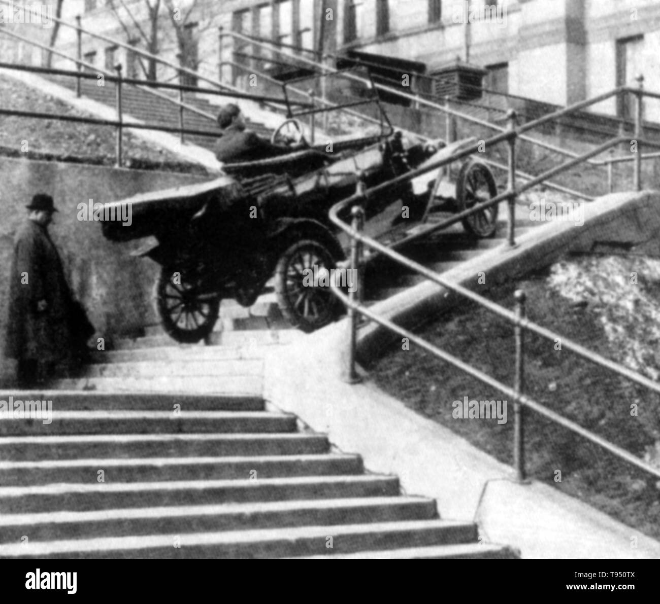 Model T ascended three flights of steps in Duluth, Minnesota, winning its owner a $100 bet. The Ford Model T (colloquially known as the Tin Lizzie, Leaping Lena, or flivver) is an automobile that was produced by Ford Motor Company from October 1, 1908, to May 26, 1927. It is generally regarded as the first affordable automobile, the car that opened travel to the common middle-class American; some of this was because of Ford's efficient fabrication, including assembly line production instead of individual hand crafting. No photographer credited, 1910s. - Stock Image
