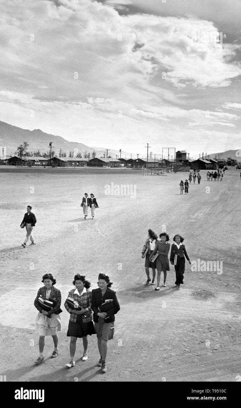 Entitled: 'School children, Manzanar Relocation Center, California.' The internment of Japanese-Americans during WWII was the forced relocation and incarceration in camps of 110,000-120,000 people of Japanese ancestry (62% of the internees were US citizens) ordered by President Roosevelt shortly after Japan's attack on Pearl Harbor. Japanese-Americans were incarcerated based on local population concentrations and regional politics. - Stock Image