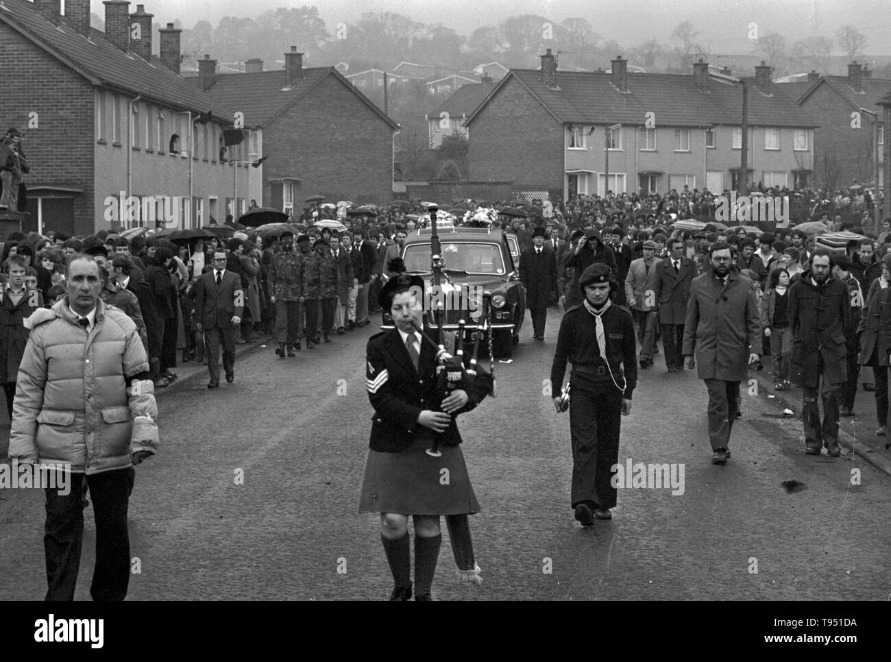 A girl piper leads the funeral procession of IRA hunger protester Bobby Sands, MP from St Luke's Church on the Twinbrook Estate to Milltown cemetery, Belfast. - Stock Image