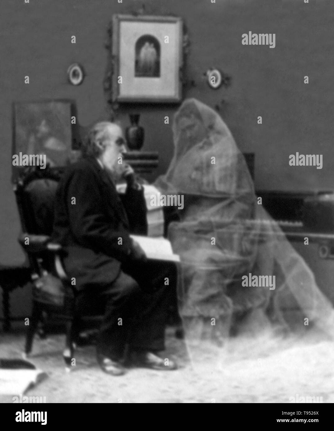 Entitled: 'Memories of the past' shows an old man seated and envisioning his wife in wedding gown. In the late 19th century amateur and commercial photographers created images intended to astonish, amuse, and entertain. The photographs were altered using a variety of techniques, including multiple exposure (taking two or more pictures on a single negative), combination printing (producing a single print from elements of two or more negatives), photomontage, overpainting, and retouching on the negative or print. The meaning and content of the camera image was significantly transformed in the pr - Stock Image