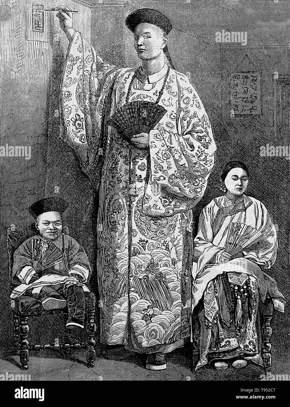 Chang Yu-sing the Chinese giant, with his wife, King-Foo and Chung Mow, a dwarf. Zhan Shichai AKA Chang Woo Gow (1841/47 - November 5, 1893) was a Chinese giant. His height was claimed to be over 8 feet, but there are no authoritative records. He left China in 1865 to travel to London where he appeared on stage, later travelling around Europe, and to the US and Australia as 'Chang the Chinese Giant'. Zhan received a good education in various countries, and developed a good understanding of ten languages. In America, he earned a salary of $500 a month. Kin Foo, the Chinese wife who accompanied  - Stock Image