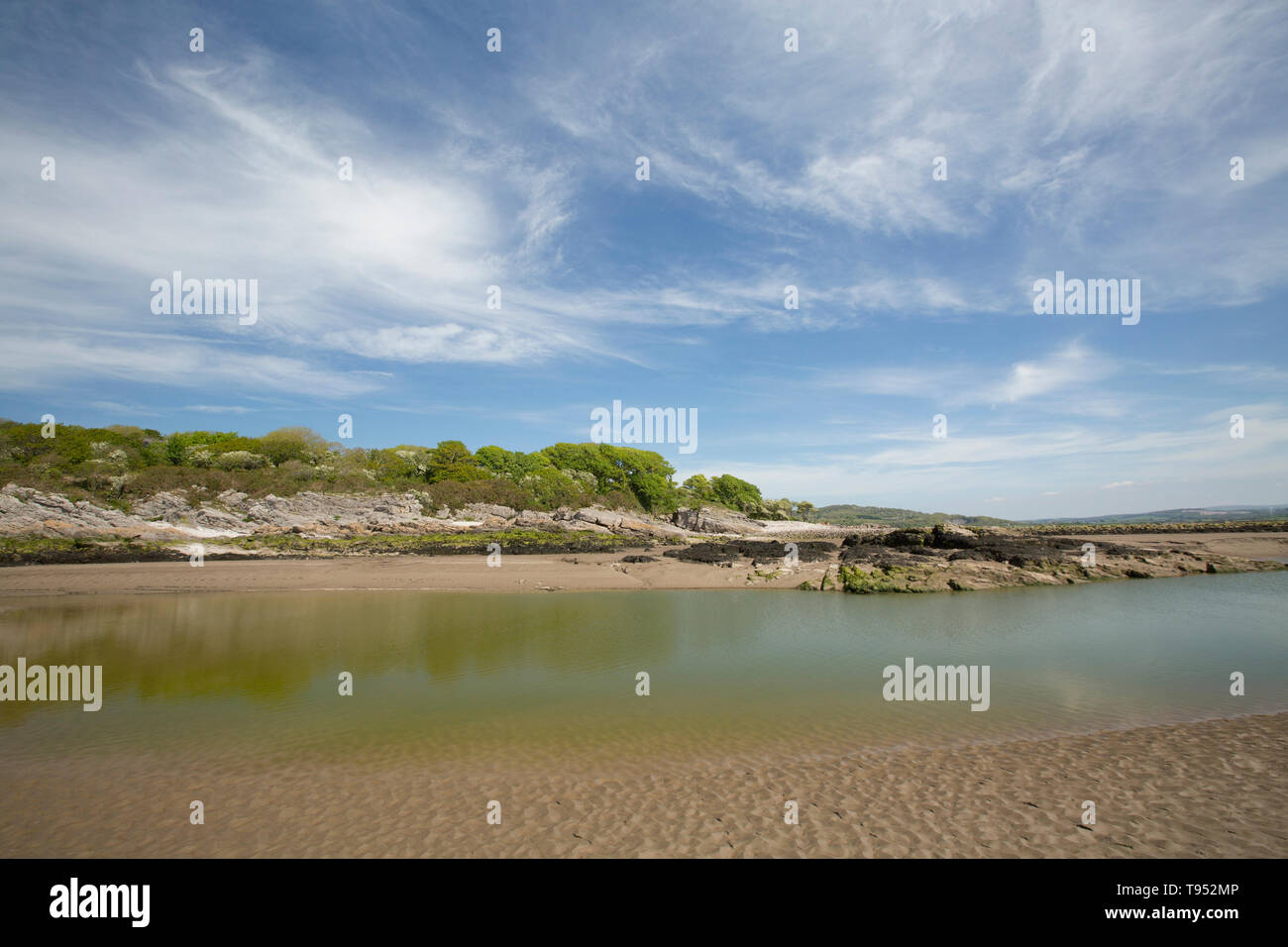 A view of an estuary channel close to Jenny Brown's Point at low tide near the village of Silverdale close to the edge of Morecambe Bay. The bay is no - Stock Image