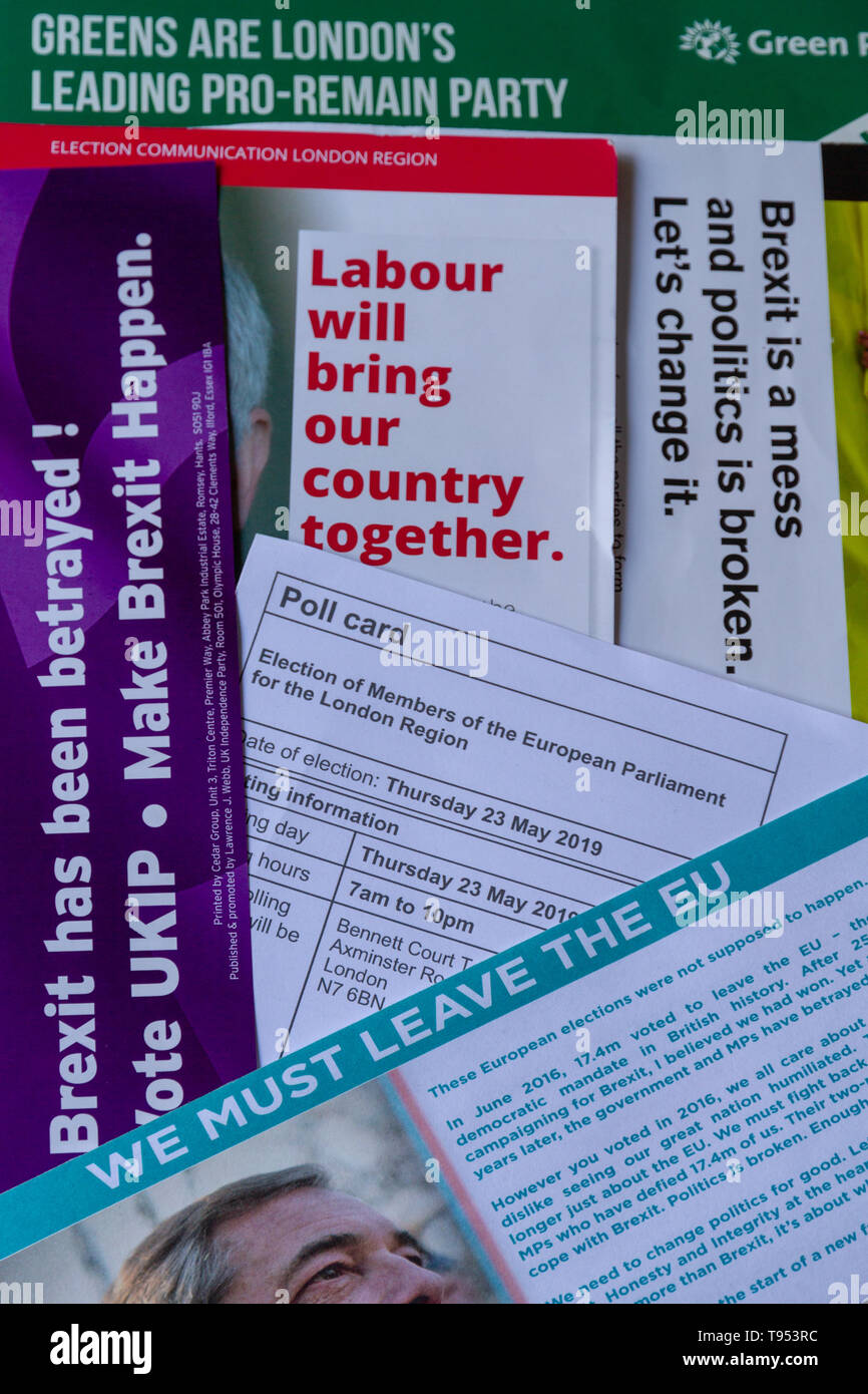 Overhead view of poll card & election material for European Parliament Elections 2019 in UK, showing different messages from the parties, portrait. - Stock Image