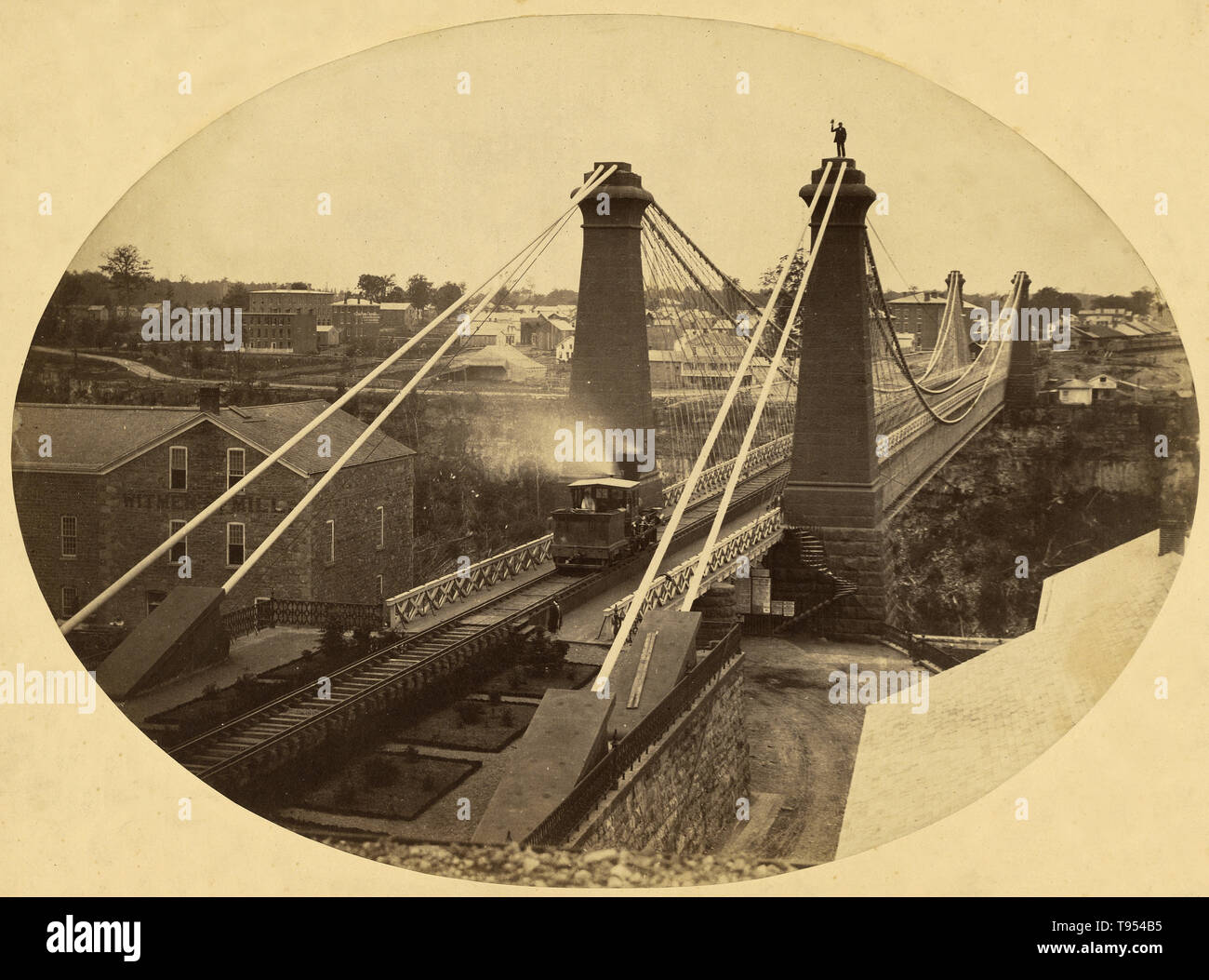 Niagara Falls suspension bridge. Silas A. Holmes (American, 1820 - 1886); Niagara Falls, Ontario, Canada; 1855 - 1860. Salted paper print. - Stock Image