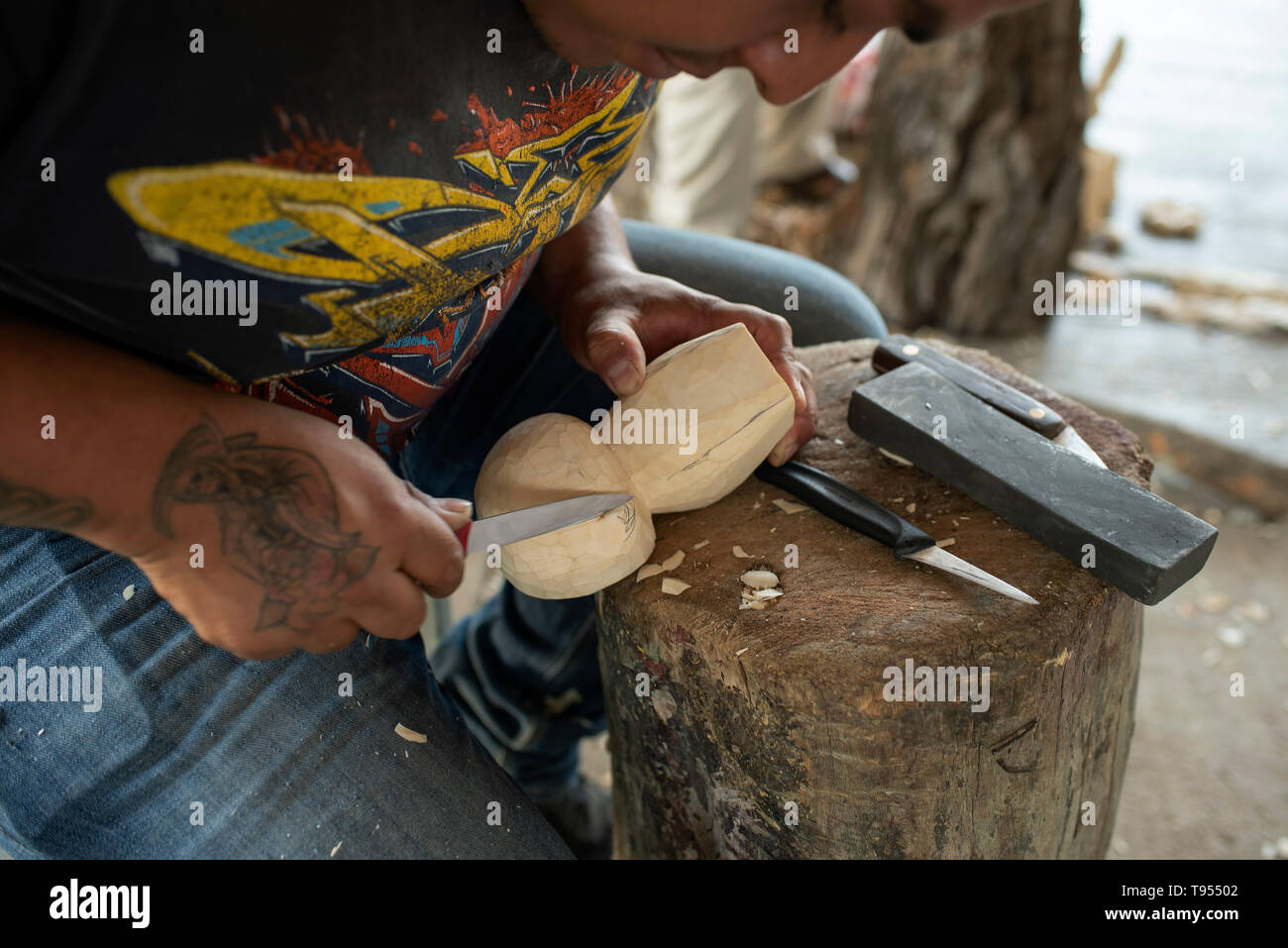 Mexican man carves native wood into alebrijes (surreal dream-like wooden sculptures). San Martín Tilcajete, Oaxaca, Mexico. Apr 2019 - Stock Image
