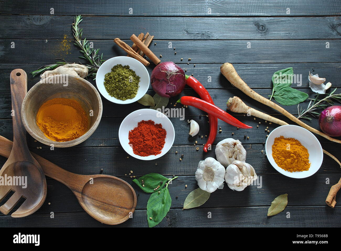 Colorful various of fresh and dried herbs, spices for cooking. Spice and herb seasoning, paprika powder, cinnamon, red onion. garlic, basil, ginger Stock Photo