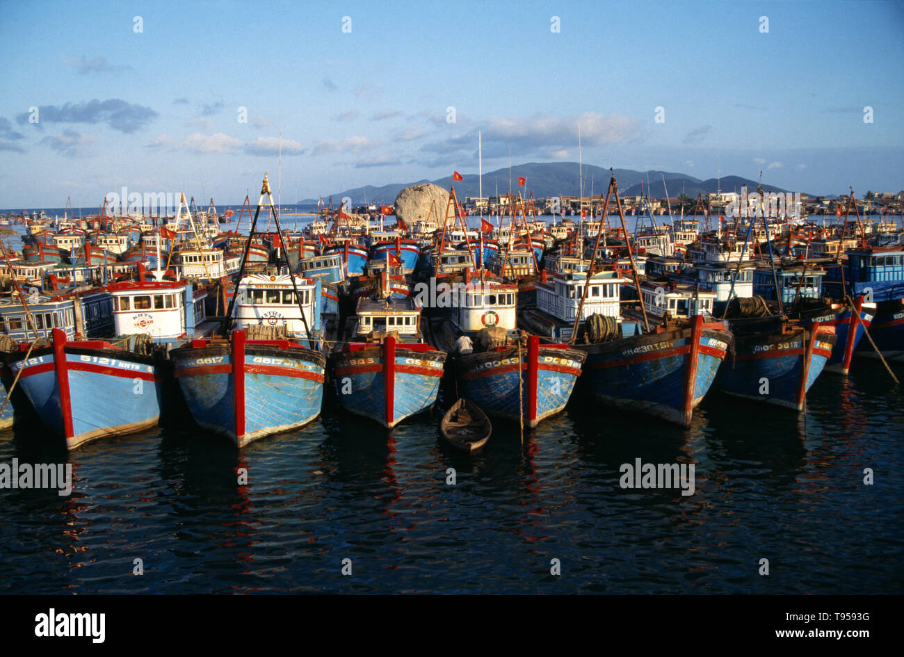 Vietnam. Nha Trang. Rows of moored fishing boats in harbour. - Stock Image