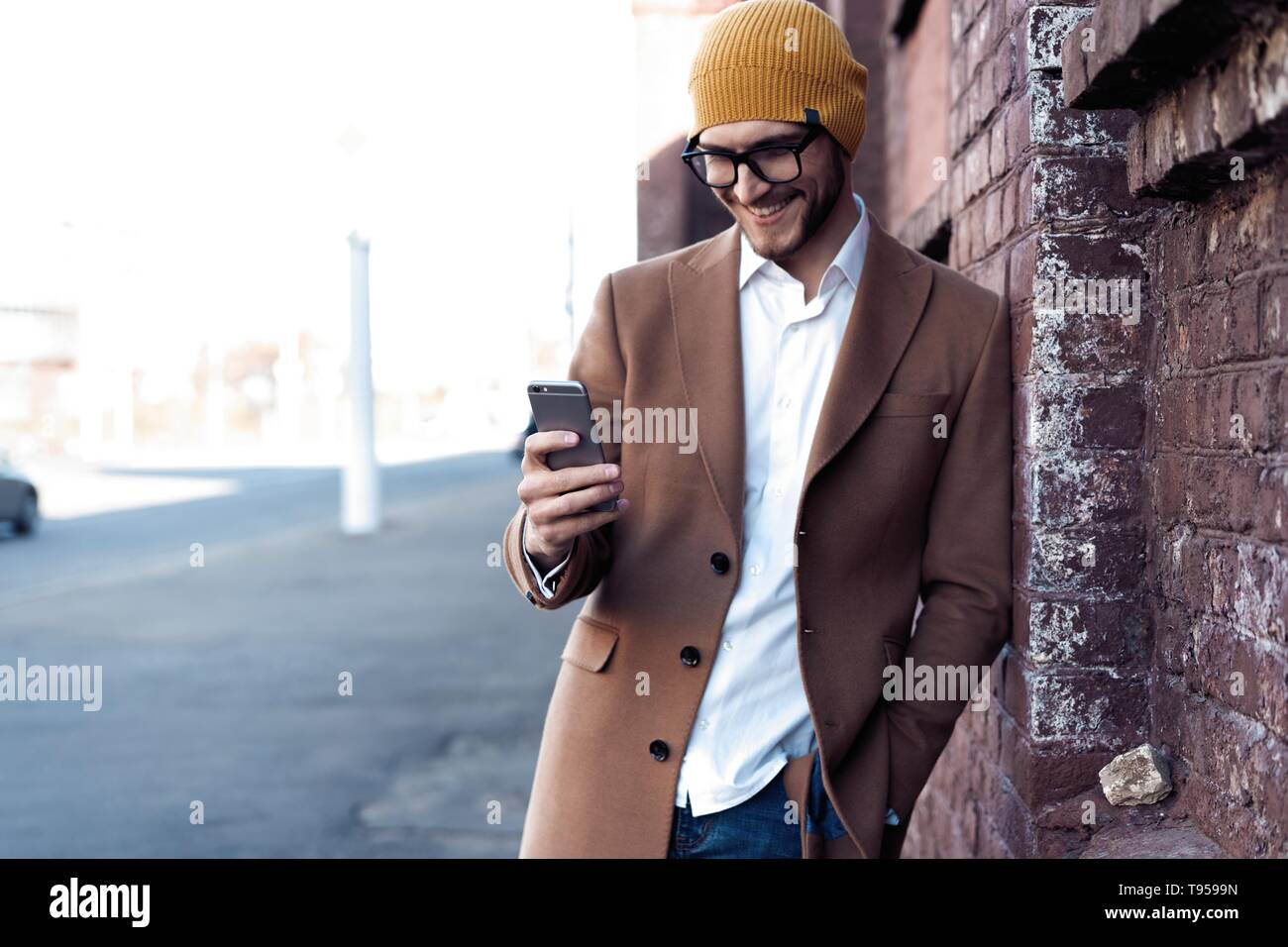 handsome hipster modern man using smart phone in the city. Stock Photo