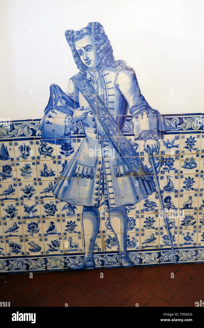 Pasteis de Belem shop interior with an illustration of historical male figure and azulejos on wall in Belem Lisbon, Portugal, Europe  KATHY DEWITT - Stock Image
