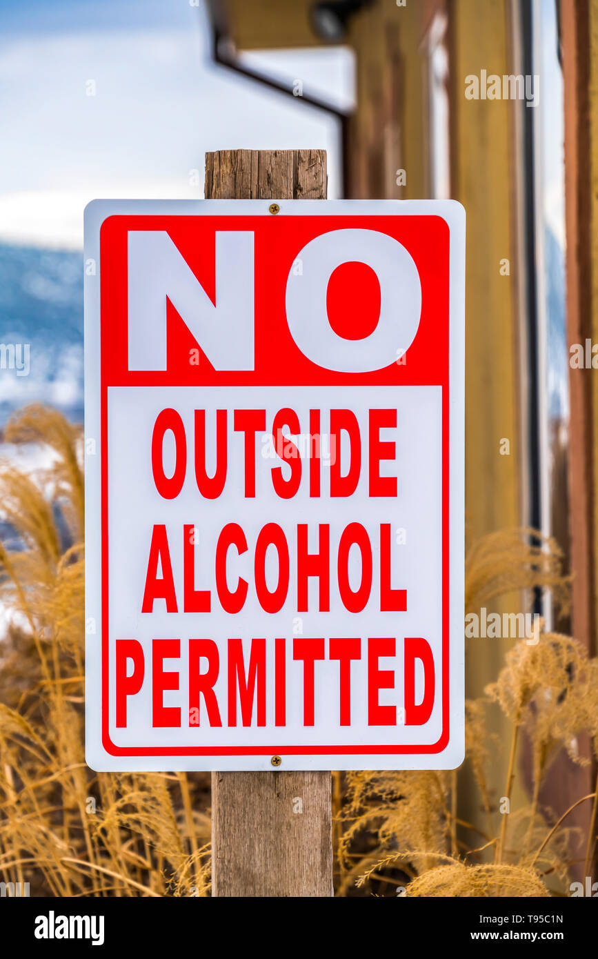 Close up view of a sign post that reads No Outside Alcohol Permitted - Stock Image