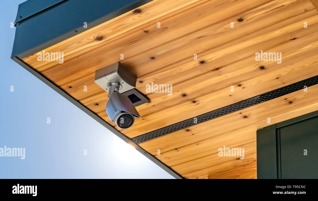 Panorama Home with security camera installed on the wooden underside of its roof - Stock Image