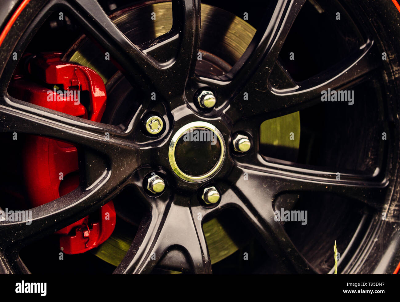 Drift inspired styling. Car wheel detail. Alloy wheel. Gloss black rim of luxury car wheel. Wheel and rim. Front or rear. Contemporary multi spoke - Stock Image