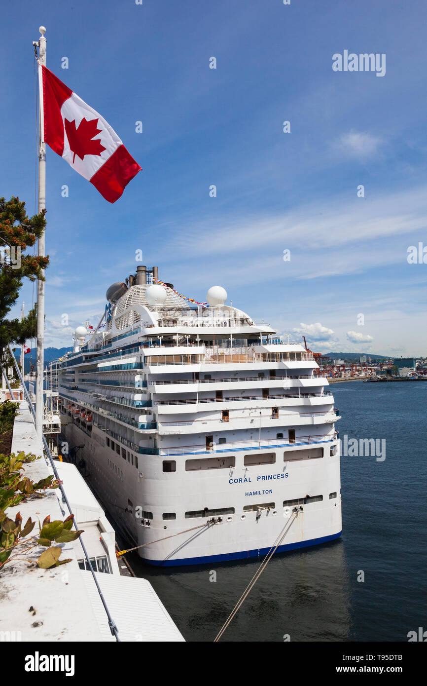 The Coral Princess cruise vessel taking on supplies and passengers at the Port of Vancouver in British Columbia Canada - Stock Image