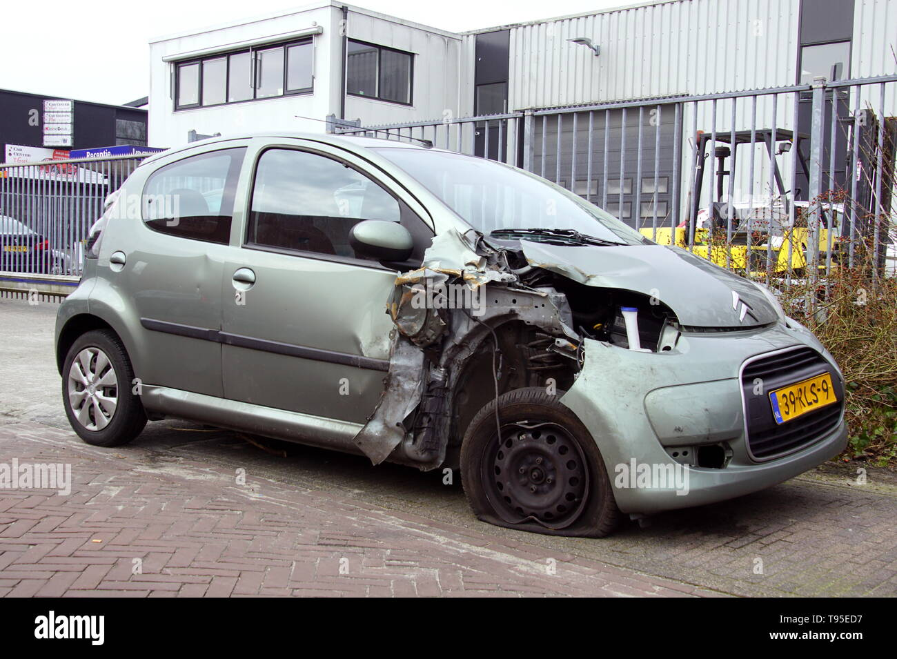 Naarden, the Netherlands - March 23, 2018: Citroën C1 with accident damage parked by the side of the road. Nobody in the vehicle. - Stock Image