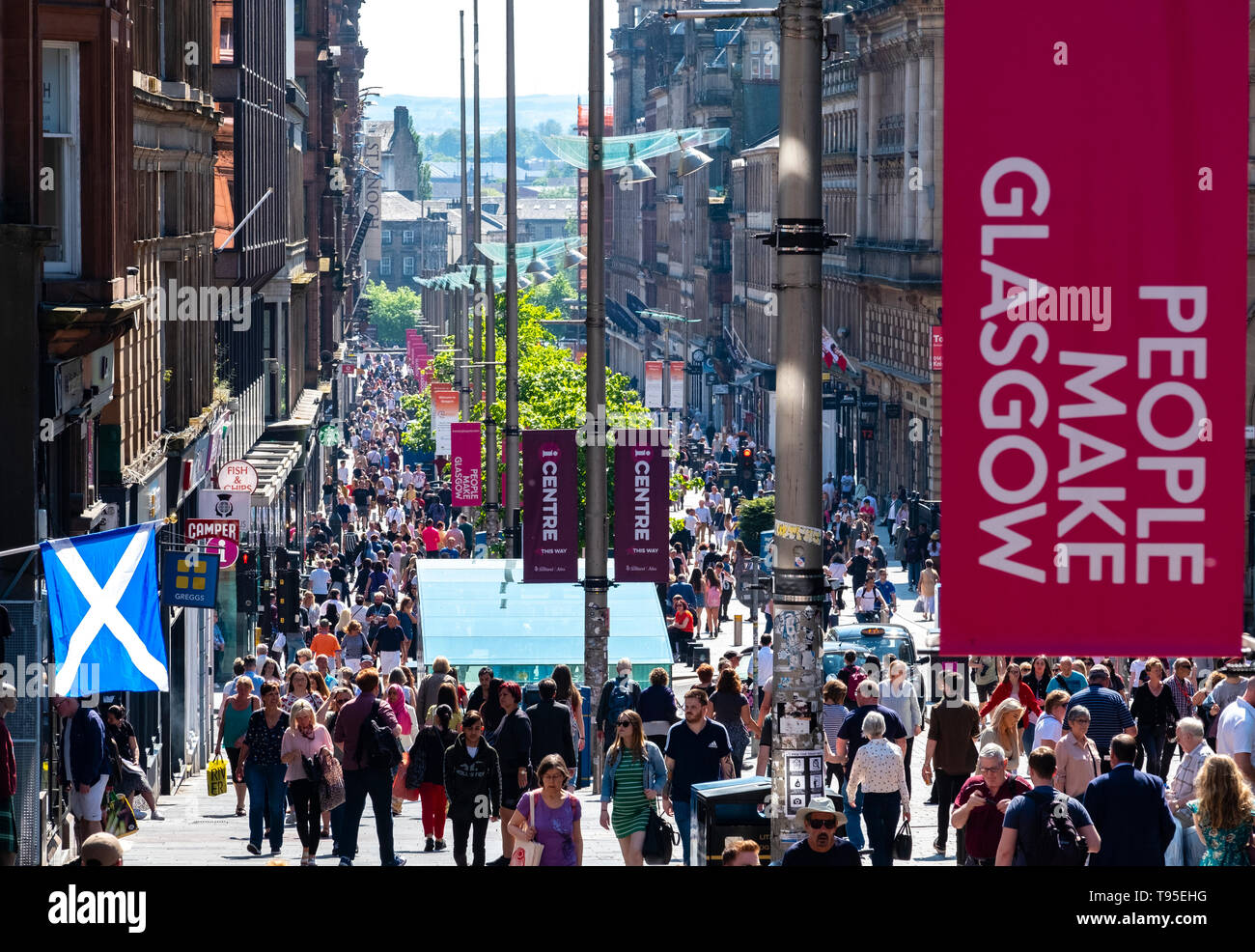 Busy pedestrian Buchanan Street in Glasgow City centre on a warm sunny afternoon, Glasgow, Scotland, UK Stock Photo