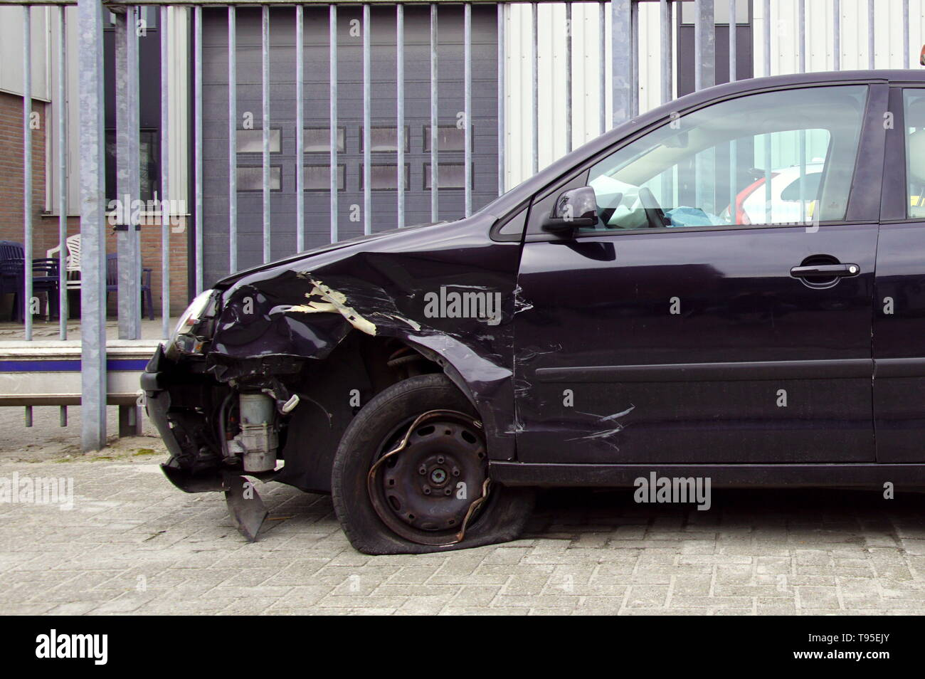 Naarden, the Netherlands - March 25, 2018: Volkswagen Polo with accident damage parked by the side of the road. Nobody in the vehicle. - Stock Image