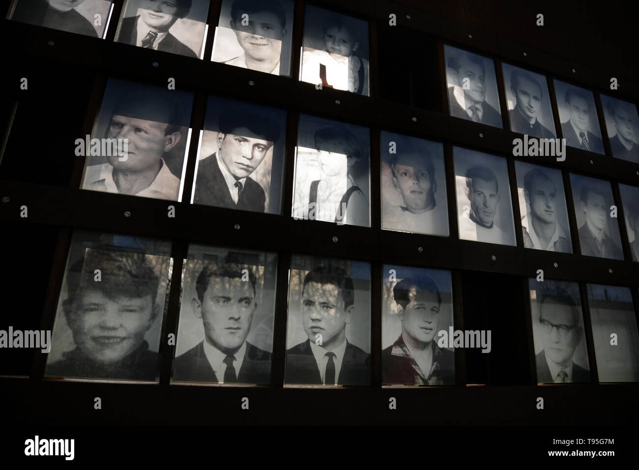Photographs of people killed while attempting to cross the Berlin Wall, at the Berlin Wall Memorial, Bernauer Strasse, Berlin, Germany. - Stock Image