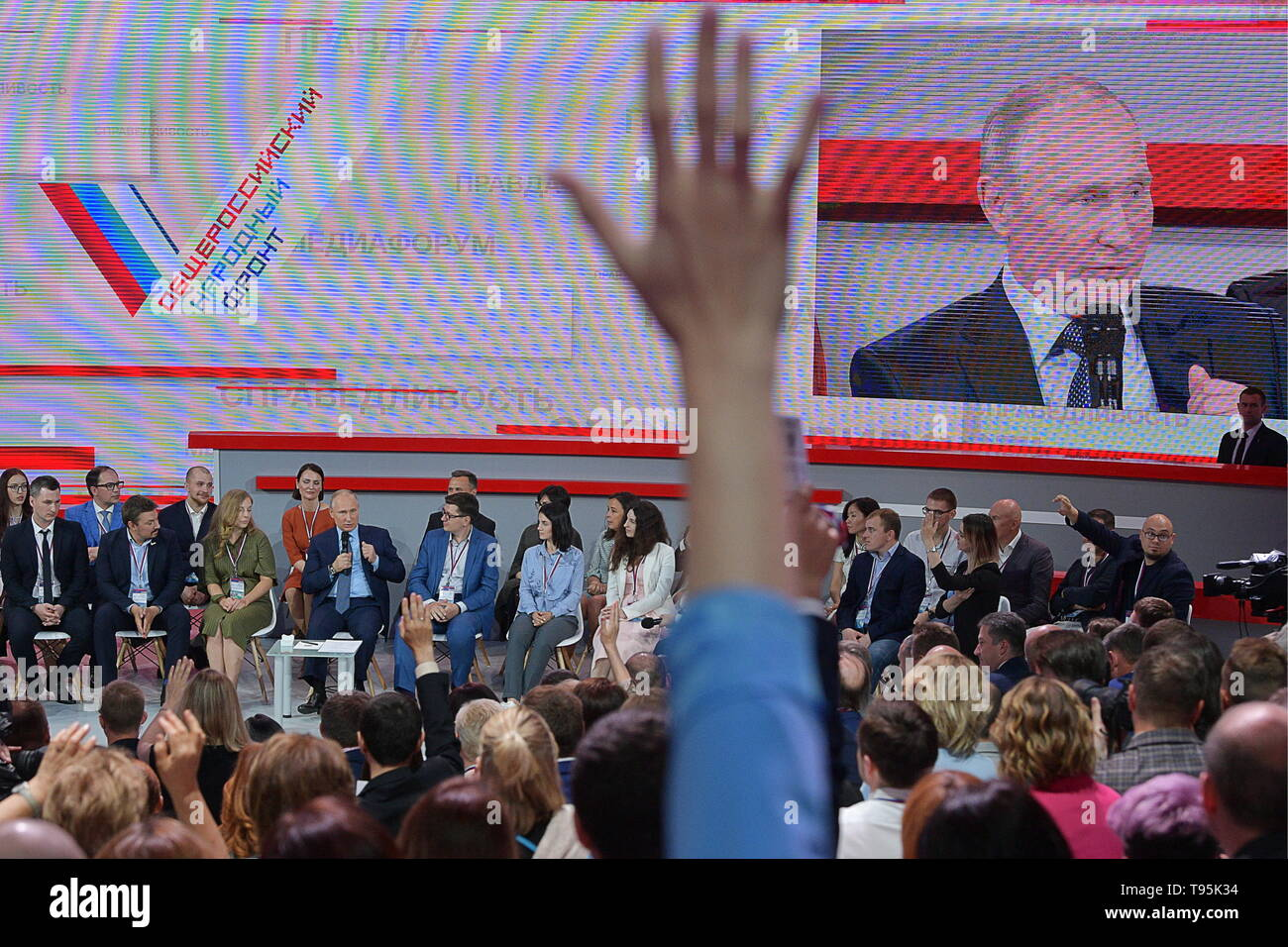 Sochi, Russia. 16th May, 2019. SOCHI, RUSSIA - MAY 16, 2019: Russia's President Vladimir Putin (4th L back) attends the plenary meeting at the 6th Independent Local and Regional Media Forum held by the All-Russian People's Front. Alexei Druzhinin/Russian Presidential Press and Information Office/TASS Credit: ITAR-TASS News Agency/Alamy Live News Stock Photo