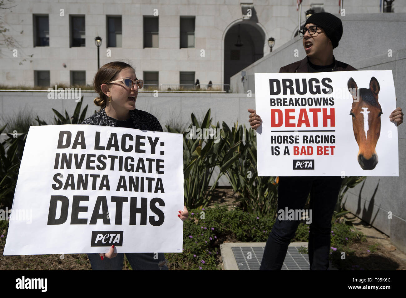 Los Angeles, CA, USA. 14th Mar, 2019. Demonstrators are seen holding placards during the protest.Animal right activists held a PETA protest against the death of 22 horses at the Santa Anita Racetrack. The protesters holding placards also called on the Los Angeles District Attorney to open a criminal investigation and suspend racing while investigating the cause of the death. Credit: Ronen Tivony/SOPA Images/ZUMA Wire/Alamy Live News - Stock Image