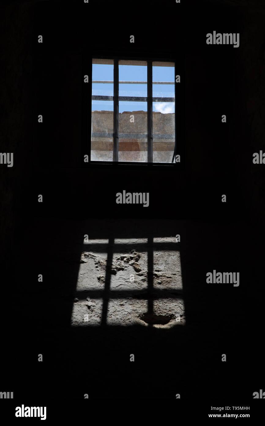 Lichtenau, Germany. 13th May, 2019. The sun shines through a barred window in the LWL-Landesmuseum für Klosterkultur, Stiftung Kloster Dalheim. Credit: Friso Gentsch/dpa/Alamy Live News - Stock Image