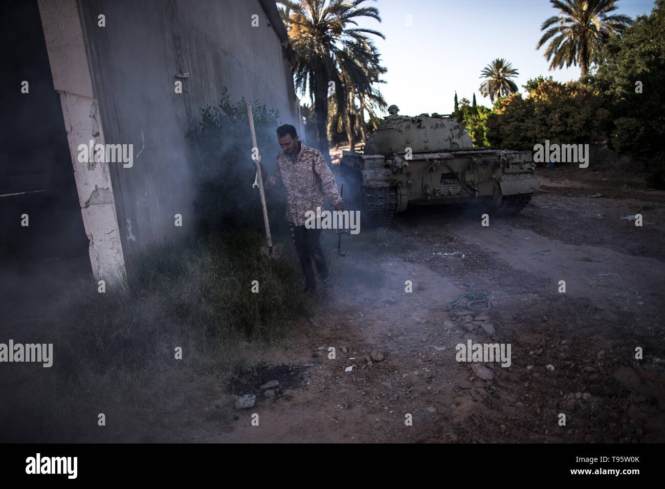 Tripoli, Libya. 16th May, 2019. A fighter from UN-backed government forces is seen in Al-Sawani frontline near Tripoli airport in Tripoli, Libya, on May 16, 2019. At least six civilians were reported killed and five more injured in an apparent airstrike in populated areas of the Libyan capital of Tripoli, Stephane Dujarric, spokesman for UN Secretary-General Antonio Guterres, said on Thursday. Credit: Amru Salahuddien/Xinhua/Alamy Live News - Stock Image