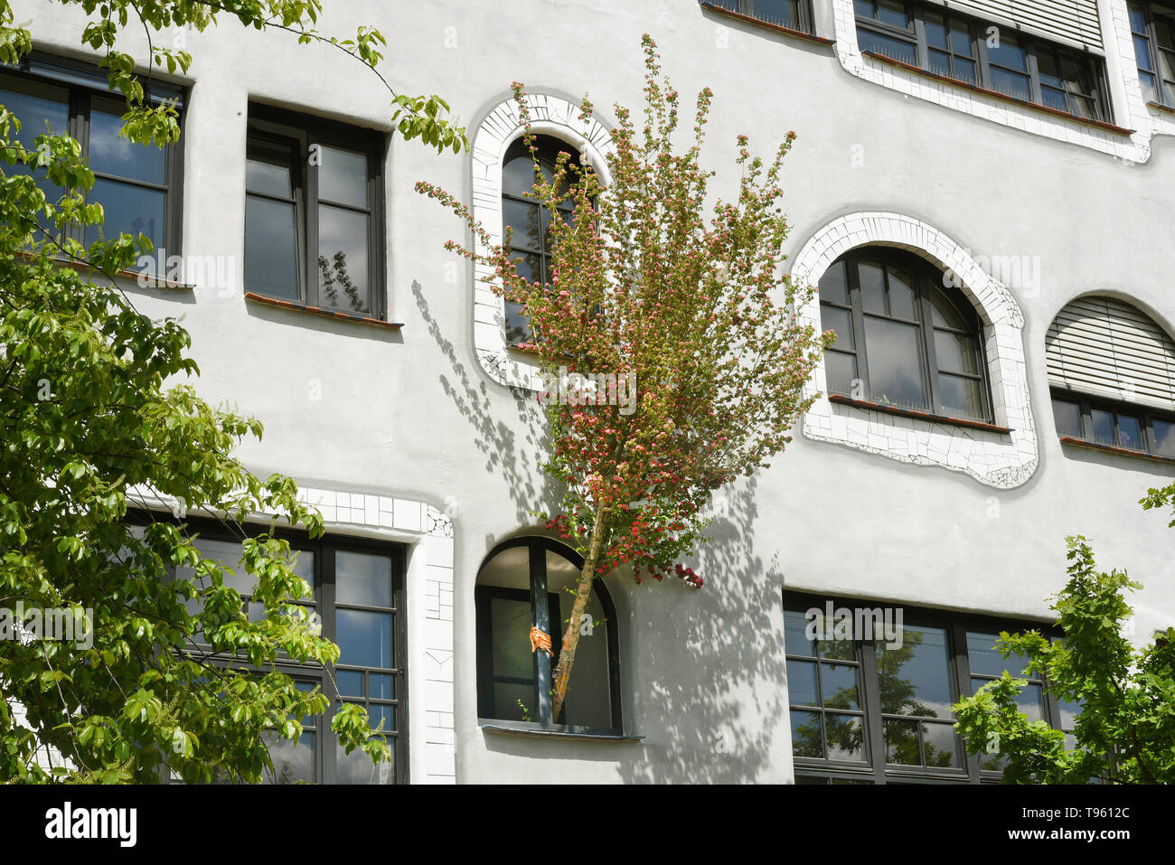 07 May 2019, Saxony-Anhalt, Wittenberg Lutherstadt: The photo shows a part of the Luther-Melanchthon-Gymnasium in Wittenberg, which was rebuilt 20 years ago according to the plans of Friedensreich Hundertwasser (1928-2000). The anniversary in Wittenberg is now being celebrated with a festival week, with exhibitions, theatre performances, concerts and the handover of a green school project. After the fall of the Berlin Wall, students from the city turned directly to the famous Viennese artist and architect with the request to transform the GDR prefabricated building into a very special place. A - Stock Image