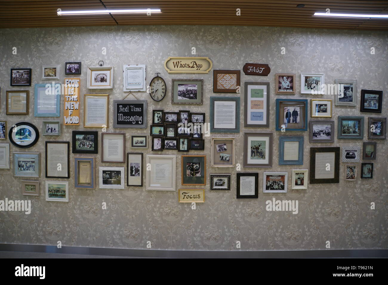 09 May 2019, US, Menlo Park: 'Memory Wall' at WhatsApp's corporate headquarters at Facebook's corporate headquarters in Menlo Park. The picture frames document important steps in the company's development. Photo: Christoph Dernbach/dpa - Stock Image