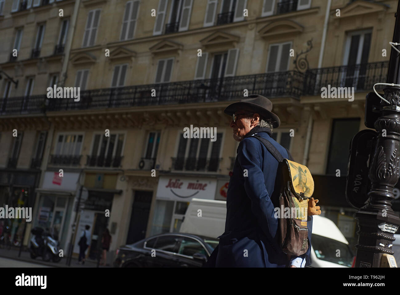 A man strolling and walking in the city centre of Paris exploring the city and its sights - Stock Image